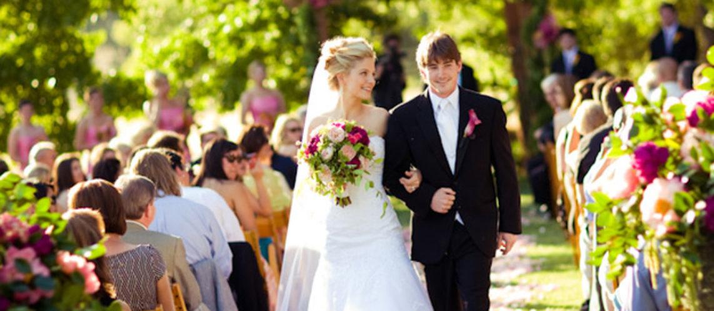 cropped-couple-aisle-pink-fuchsia-bouquet-40306.jpg